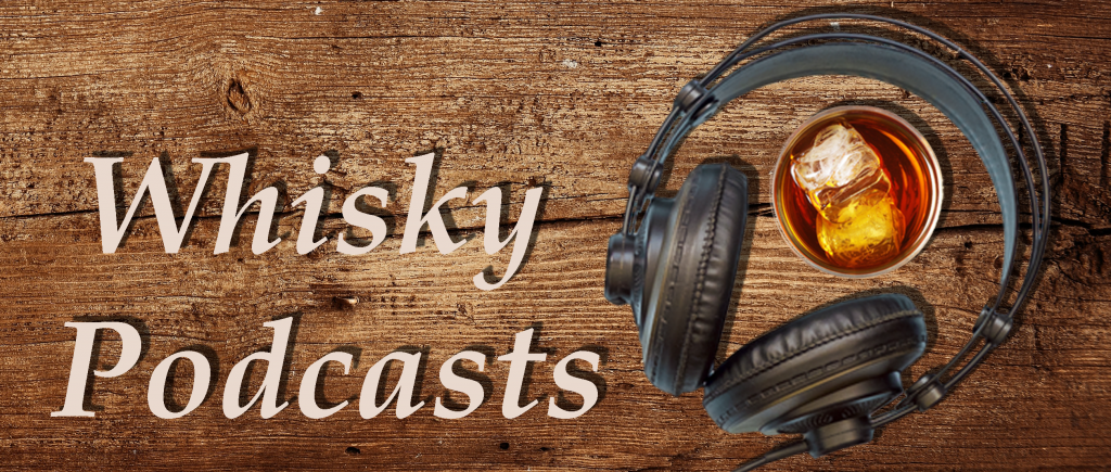 wood background with whisky glass and headsets